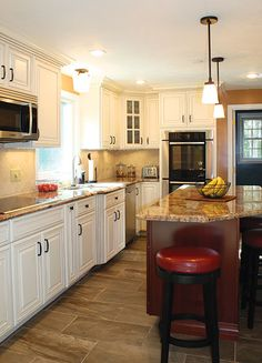 Full overlay painted cabinet with glaze. Cherry center island. Granite Crema Bordeaux