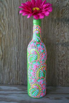 Hand-painted And Recycled Wine Bottle - turn an old wine or liquor bottle into an elegant vase! Start by painting the bottle pastel aqua then add paisleys and dotted detailed designs with puff paint or acrylics. So pretty! Super creative upcycle project!