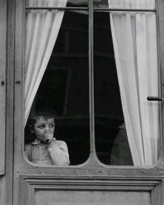 Paul Strand - I like how the picture was taken from the outside of a window and the child isn't staring at the camera. This picture gives characterization to the child since he or she is sucking their thumbs, giving insight of life from the photographer's time.