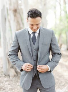 Southern california outdoor into the woods wedding shoot groom grey notch lapel suit with a matching vest and white dress shirt with a long charcoal grey tie buttoning jacket close up Gray Groomsmen Suits, Groomsmen Fashion, Bridesmaids And Groomsmen, Woodland Wedding Inspiration, Wedding Ideas, Wedding Shoot, Wedding Attire, Wedding Planning, Suits