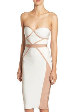 Turning heads in this chic body-con dress with blush-colored piping and a bustier bodice.