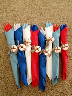 wrap one color of utensils with another color napkin. white life savers and twine to embellish