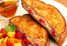 Breakfast doesn't get better than this...it takes just 20 minutes to prepare this tasty French toast, stuffed with a mixture of peaches, raspberries and cream cheese. Topped with more fruit, this is a breakfast sure to get them out of bed.