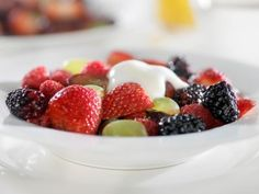 Fresh Fruit Salad with Honey-Yogurt Dressing Recipe by  via @SparkPeople