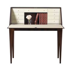 """Varenne Writing Table is gracefully proportioned and luxuriously detailed. Clad in Book-matched macassar veneers, it is inspired by the French """"escritoire"""", or writing box, characterized by interior compartments or drawers and a """"fall front"""" desktop. Meticulously outfitted in the interior with nine lacquered drawers, faux ivory pulls, and a locking leather desktop, just gorgeous!"""