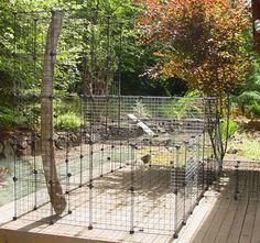 Build A Do-It-Yourself Outdoor Cat Enclosure Or Run from Metal Storage Cubes in paks of 4 or 6 (K Mart, here; Target, on sale)