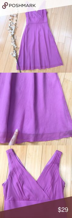 J. CREW purple silk dress, 4. So so beautiful pinky purple silk dress by J.Crew, size 4. Gorgeous! There is one small mark that looks like pen or pencil near the bottom hem, not visible while being worn. Bust is 18 inches across and could accommodate up to 2 inches more, waist is 14.25 inches across and not stretchy, length is 41.5 inches. This dress will be dreamy and perfect for a spring or summer wedding! J. Crew Dresses Midi
