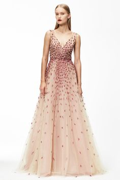 Monique Lhuillier Pre F 15: Anna Kendrick wore this stunning blush gown with red embellishments to the 2014 Golden Globes. This is an exquisite gown fit for a princess!