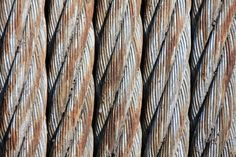 #braided #industry #lines and curves #oxidation #pattern #row #rust #spiral #steel cables #strong #texture #wire