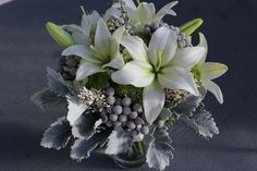 gray and green wedding bouquet lily  http://sophisticatedfloral.com/