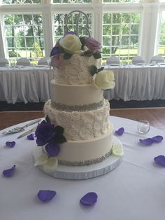buttercream rosettes with silver beaded border and purple floral