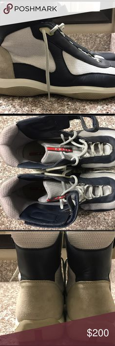 Men's Prada Hi-Top Sneakers Blu/Sil/Wht Size 15 Prada Hi-Top Sneakers Men's 15   Blu/Sil/Wht  Only have been worn twice.   Still look new except slight discoloration of plastic parts shown in picture..  No box   Wiped down before shipping  Shipping (2-3 days)  Can pay through PayPal.. Prada Shoes Sneakers