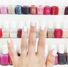 Paint a base coat of white polish before you paint a neon color. Your polish will be brighter and more true to tone with fewer coats.