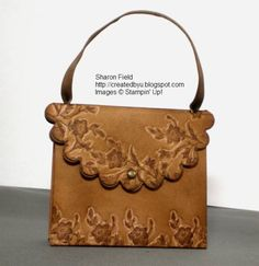 Pretty, reminds me of a leather purse I had in high school in the 70's