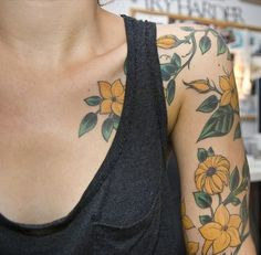 colour / flowers / nature arm/shoulder tat [This dainty floral arrangement: | 23 Stunningly Delicate Tattoo Sleeves That Are Beyond Dreamy]