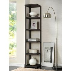 Organize your essentials with this unique, stylish Gutierez Etagere Bookcase. Different level contoured shelves and a versatile construction highlight this beautiful bookcase. Display special items and showcase your unique style with this versatile shelf design.