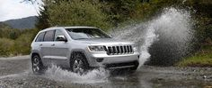 The 2011 reintroduction of the Grand Cherokee was a dramatic departure from its predecessor. From the ground up, the exterior was sculpted and refined, giving it a sportier appearance while incorporating classic Jeep styling cues including the seven-slot grille, rounded headlamps and trapezoidal wheel arches.