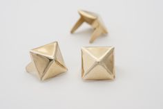 Medium Brass Pyramid Stud Medium size pyramid with shiny golden finish. The stud has no plating so it lets the golden brass color through. Pyramid Studs Category An attractive and basic shape, this stud head is Leather Diy Crafts, Leather Craft, Studs And Spikes, Basic Shapes, Brass Color, Solid Brass, Vintage Outfits, Place Card Holders, Crafty