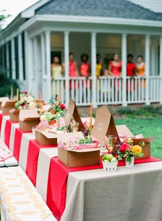 I love the bright colours in this outdoor picnic style wedding. I also adore the bridesmaids looking on in their sunshine coloured dresses. Image courtesy of Pinterest.