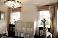 The nursery has a Fortuny light!  Custom linen curtains and Hunter Douglas blinds.  Charming barley twist side tables from Portobello.