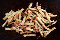Hot fries tossed in a quick and easy garlic aioli (that starts with mayonnaise) and then topped with grated Parmesan cheese. Use any type of fry- baked, fried, fresh-cut or frozen and take your fries to the next level. A garlic lovers dream fry!