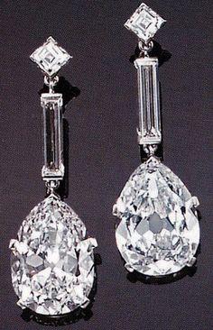 An impressive pair of diamond and platinum drop earrings, Cartier, Paris.