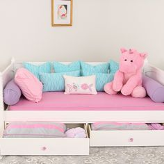 Pretty in Pink! This inexpensive daybed cover is an elasticized mattress cover with piping.  Stays in place for daytime seating.