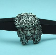 The Face Of Jesus. Hand carved in wax and cast in sterling silver by Link Wachler. On adjustable rubber bracelet. Jesus Face, Rubber Bracelets, Custom Jewelry Design, Service Design, Hand Carved, Wax, Lion Sculpture, Carving, Statue
