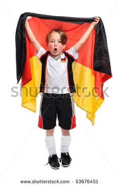 "Kid / Boy in complete german soccer outfit holding a german flag an sings ""ole ole ole ole"" - stock photo"
