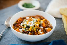 When people get a slow cooker, chili is often the first thing they make with it. And why not? With minimal effort and several hours of hands-off cooking, you're gifted with a robust meal that feeds a crowd. This version is especially winning with its delicious, healthful mix of ground turkey, sweet potatoes, black beans, tomatoes, and chipotles.
