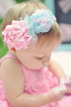14.00 from http://www.etsy.com/listing/79711446/cotton-candy-bow-headband