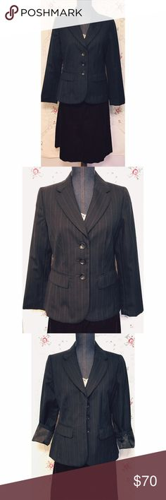 """Ann Taylor 8 Petite NWOT Wool Blend Blue Jacket This jacket/Blazer by Ann Taylor Petites has never been worn; the remove-before- cleaning tag is still attached and the pockets are unopened. Wool/poly blend in Navy with light blue pinstripes. Dry cleaning recommended. Four buttons on sleeves and extra buttons present. Size 8 Petite. Length is 24.5"""", sleeves are 23"""", shoulder length is 15.5"""" and bust measures 37"""". In NWOT condition. Ann Taylor Jackets & Coats Blazers"""