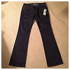 Miss Me Jeans NWT Miss Me Jeans.  Dark wash and boot cut.  Orange stitching throughout.  Has some stretch to them.  From waist to ankle is 43 inches long and the inseam is 33.5 inches long.  Never worn. Miss Me Jeans