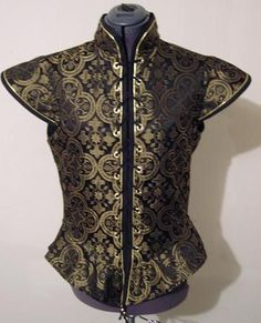 I like this a doublet for Hamlet with a black shirt underneath. His color scheme is black/gold