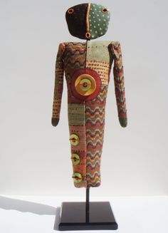 Fiber art doll with polymer head. Looks tribal - love the colors.