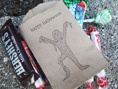 9 Spook-tacular Kids' Halloween Party Ideas | BAG OF TRICKS | These vintage-style goody bags (check out the mummy stamp print!) are just the right size for storing loads of little treats. Buy It Now! Mummy Halloween Goodie Bags, $4, etsy.com