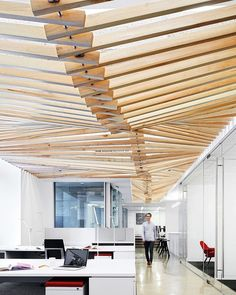 A canopy composed of two-by-fours extends above the office area at Turelk's Los Angeles headquarters by Gensler, who incorporated the firm's…