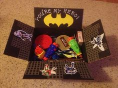 Super Hero Care Package- Youre OUR Hero! Would be so cute to send an Uncle (from the nieces/nephews) who is serving a mission.
