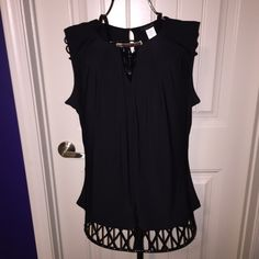 Black sleeveless blouse Sophisticated black sleeveless blouse.  Gold bar accent at neckline.  Small keyhole with button in the back.  Looks great worn alone or with a blazer over it paired with skinny jeans & cute booties!  Worn once!  In like new condition! Tops Blouses