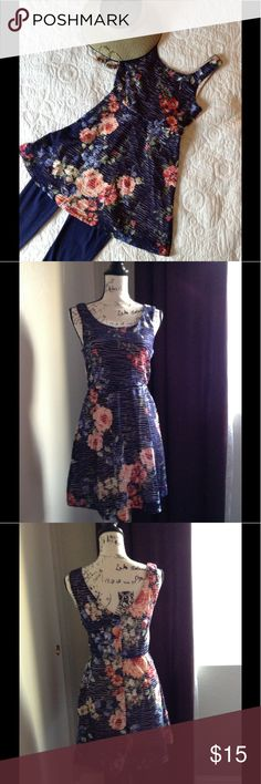Three Pink Hearts navy flowered dress Fresh navy dress styled with peek through to the beige lining.  95% polyester, 5% spandex.  Imagine it with sunglasses and straw hat in a tropical spot or with leggings and a shrug for a crisp autumn night. Three PInk Hearts Dresses