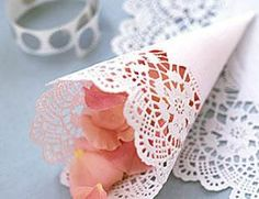 Freeze dried rose petals wrapped in doily cones for ceremony confetti