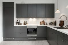 Love this kitchen in charcoal greyfromEpoq| Photo by Swedish broker Alvhem | via Style and Create