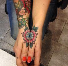 Traditional flower, mandala, hand tattoo