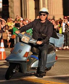 """Tom Hanks on a Vespa Scooter at the """"Larry Crowne"""" movie premiere 