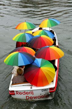 Color Theory Therapy| Serafini Amelia| A Collection of Rainbow Umbrellas & a Boat
