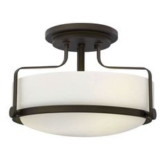 Hinkley Harper Collection Light Flush Mount features an Oil Rubbed Bronze Finish and Etched Opal Glass. Harper's sleek, retro design elevates the traditional flush mount with a unique opal glass bound by a prominent metal ring and decorative knobs availab Hallway Lighting, Strip Lighting, Chandelier Lighting, Modern Lighting, Lighting Ideas, Ceiling Lighting, Chandeliers, Ceiling Lamp, Bedroom Lighting