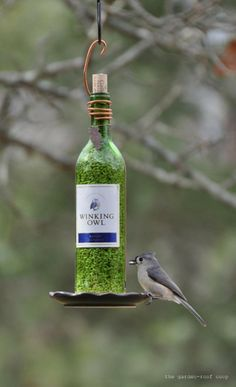 Wine Bottle Bird Feeder - On the list of 7 ideas, click on the bird feeder link above this picture. The tutorial is instructive for those unfamiliar with drilling into glass. I think I could do it.