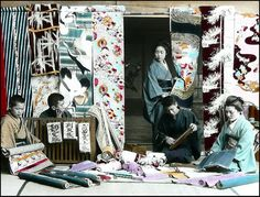 Selling colorful kimono silk bolts on a shopping street. Tamamura-Saving to see how fabric was typically rolled in the time period Old Pictures, Old Photos, Vintage Photos, Japan Landscape, Japanese Textiles, Japan Photo, Okinawa, Japanese Culture, Vintage Japanese