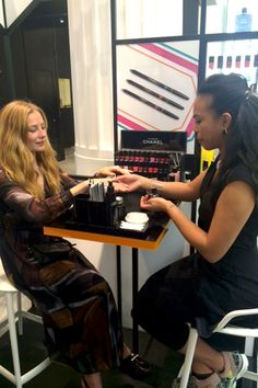Clara Paget having a Chanel manicure at Selfridges.