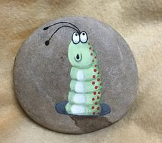 Stone - Woah - Where am I? Hand painted with Acrylic on a small stone. 2 1/2 approximate. Pebble glued to back with E6000 to create a stand. Coated with satin polyurethane for durability. No full sun and no water recommended.